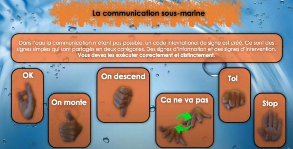 communiquer sous l'eau les signes de la main